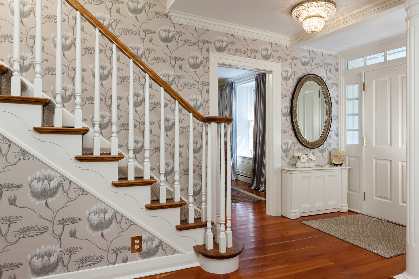 Wallpapered traditional foyer by Grant Gilvesy Design