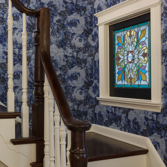 Wallpapered transitional foyer by Grant Gilvesy Design